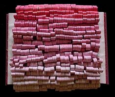 Saffron Skies. Hundreds of flowing paper loops float out of this book sculpture wall decor in billows of pink splattered with flecks of gold -- just like those final moments of the sunset.