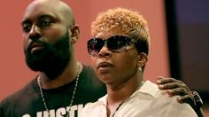 Michael Brown Sr. and Lesley McSpadden listen to a speaker during a rally Aug. 17, 2014, for their son who was killed by police the week before in Ferguson, Mo.