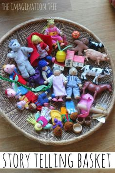Fairytale and other story book characters in a basket.  Encouraging story telling.