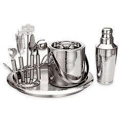Sleek and contemporary, Godinger's Hammered Stainless Steel Bar Set includes everything you need to get the party started. Each piece is beautifully crafted in stainless steel with a mix of satin and polished, hammered surfaces.