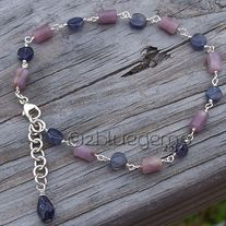 "Stunning and elegant is the best way to describe this beautiful bracelet.  Cylindrical Lepidolite beads and coin-shaped Iolite beads are paired together in this delicate, but eye-catching piece.  Bracelet measures 7 1/4"", closes with a Sterling Silver lobster clasp, and has a 3/4"" Sterling Silv..."