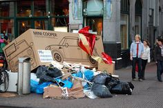 "mini cooper as christmas presents, discarded boxes. Really a great idea which was originally done in 2004 by Paris' City Transit Authority which ran ads proclaiming ""One New Bus Per Day"" but this was a photoshop image. Dutch creative agency Ubachswisbrun JWT took this concept a step further, by actually making enormous cardboard boxes with Mini Coopers printed onto them."