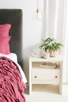 White nightstand, grey bedhead (Anthropologie)