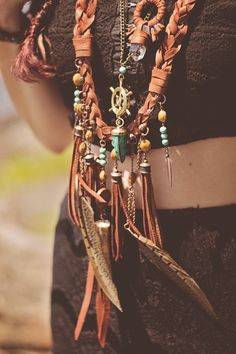 Gorgeous bohemian necklace of leather, turquoise, bronze & feathers. Sailors Omen via DISfunkshion Magazine.