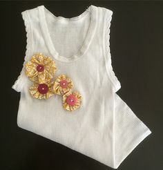 { B A B Y  G I R L  E M B E L L I S H E D  S I N G L E T }  Adorable hand embellished baby girl singlet with button flower detail.  Would make a gorgeous gift for the little princess!  Singlet is sized 000 (3 Months). https://www.etsy.com/au/listing/268594822/baby-girl-embellished-singlet-button  #handmade #babygirl #yellow #pink #flowers #buttons #adorable #saxonandlola