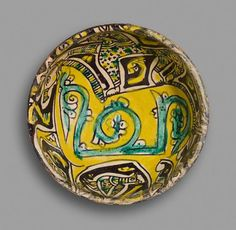 Bowl with a Cheetah Standing on the Back of a Horse Vessel 10th century Samanid period, AH 204-395 / AD 819-1005 Creation Place: Nishapur, Iran Buff-colored earthenware painted with black (manganese and iron), yellow (lead-tin), and green (copper) under clear lead glaze 7.4 x 18.6 cm (2 15/16 x 7 5/16 in.)