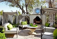 cute backyard! four cabanas w/striped awnings; black & white mix so well with the green! berkley vallone