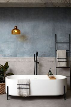 The interior designer has combined this vintage bathroom with a modern touch . The interior designer has combined this vintage bathroom with a modern touch
