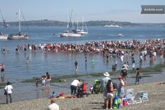 Crowds on Alki beach waiting for the Seafair pirates to arrive - an annual event in July