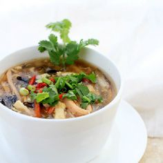 Traditional Chinese hot and sour soup with ham, tofu, mushrooms and eggs.