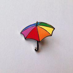 Rainbow umbrella hard enamel pin. 25mm tall, secure rubber backing.