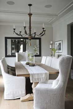 Slip covered sinking room chairs.