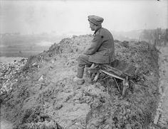 WWI, Nov 1916, Somme, Battle of the Ancre: British soldier of a working party resting, Mametz-Contalmaison road. ©IWM