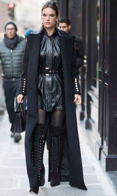 Alessandra Ambrosio wearing an Ellery dress, Versace belt, Wolford tights, Elizabeta Franci boots, a Dsquared coat and Saint Laurent bag