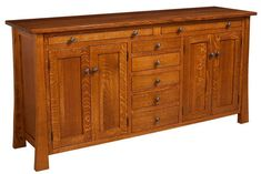 The handcrafted Amish Grant Sideboard is the ultimate storage cabinet for your everyday kitchen and dining essentials. With 5 drawers, 4 cabinet doors, and 2 pull-out serving trays, this solid wood buffet offers plenty of storage options and serving space, for your family get together's or entertaining needs. Additional features of this lovely buffet include full extension drawers and one adjustable shelf behind doors.