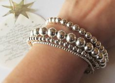 'Stacking Bracelet Set of 4 '  This set features 4 iconic and timeless sterling silver bead bracelets. One of each of the following sizes - 2mm, 4mm, 6mm and 8mm silver beads in the bracelet length of your choice.  A joyful addition to any woman's jewelry collection. A great and easy way to get that contemporary layered look. Sterling Silver Bead Bracelet Set of 4 Christmas Gift for Her by NikkiHillsDesign on Etsy