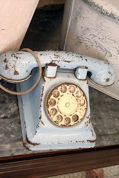 Would really like one of these - Old chipped Bakelite telephone