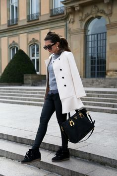 FashionHippieLoves. Grey sweater+grey and black lace blouse+black skinny jeans+black sneaker wedges+white coat+black handbag+suglasses+pearl earrings. Winter Casual Outfit 2017