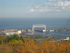 Great lakes freighter heading out of Duluth harbor under lift bridge.