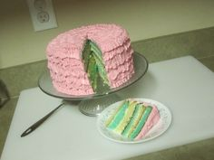 Pink ruffle cake with green and yellow layers.  My first attempt at ruffles