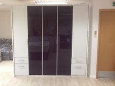 Purple and white, 5 door ceiling high wardrobe with drawers.