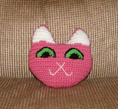 Cute kitty shaped pillow. Measures 8 inches x 8 inches.