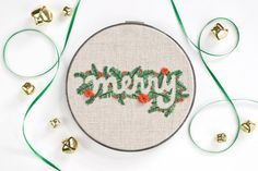 This free hand embroidery pattern uses evergreens and negative space to express a very merry seasonal sentiment.
