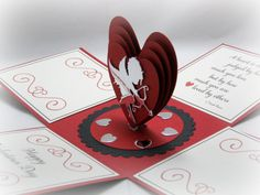This Valentine Exploding Box Card has a 3 dimensional heart with Cupid in shiny silver paper as its centerpiece. The sentiment is a quote from Pop Up Box Cards, 3d Cards, Love Cards, Xmas Cards, Valentine Cards, Exploding Box Template, Exploding Box Card, Surprise Box, Paper Hearts