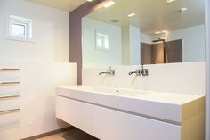Bespoke Boform bathroom furniture with sink in Corian and mixers from Vola