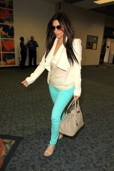 i love kim's outfit and the bright aqua / teal colored pants! #kardashian