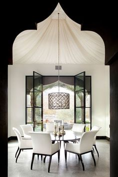 Love the tenting and the Moroccan shaped archways! This is a great example of how you can start with a very simple color pallete and still end up with a dramatic space!