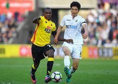 Watford's burly striker Odio Ighalo uses his body to shield the ball from Ki Sung-Yueng of Swansea
