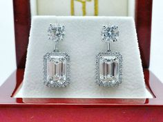 rubies.work/... Emerald cut diamond earrings