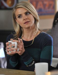 c3aeee2f02 Jane s navy green striped sweater on Happy Endings
