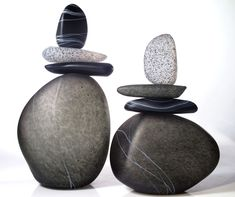 """Melanie Guernsey-Leppla, """"Cairn Rock Totems in Gray"""".  Capturing a balanced moment in time, these Cairns, Born of fire and glass represent accomplishments, knowledge and experience gained, difficulties overcome and guidance for pathways yet to be traveled. Each unique composition of free blown and solid glass stone forms is individually shaped by the artist, fused together in the flame and finally etched to create the stone like finish."""