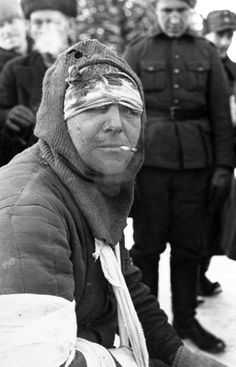 Dec 1939. An injured Soviet soldier who has been taken as a POW by the Finns during the Winter War waits to be treated by a medic. The Finnish-Soviet Winter War began with the Soviet invasion of Finland on 30 November 1939 and ended with the Moscow Peace treaty on 13 March 1940. The Winter War would be followed by the Continuation War between the Soviets and Finland, 22 June 1941.