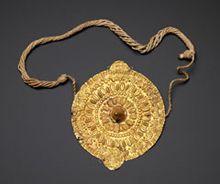 Pendant (akrafokonmu) Asante peoples, Ghana. Late 19th to early 20th century Gold alloy, plant fiber. Museum purchase, 2008-3-1