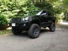 Superlift OME HD coils up front, with one coil cut. 2 inch spacer in the rear and Bilstien on all 4 corners. Jeep Cherokee Laredo, 2005 Jeep Grand Cherokee, Grand Cherokee Overland, Jeep Cars, Jeep Truck, Jeep Wk, Jeep Garage, Jeep Photos, Black Jeep