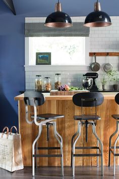 Entertaining is a breeze with a large wooden island with industrial stools that surround it. White subway tiles lay a nice, crisp backdrop for the bold blue hues. >> http://www.hgtv.com/design/hgtv-urban-oasis/2015/kitchen-pictures-from-hgtv-urban-oasis-2015-pictures?soc=pinterest