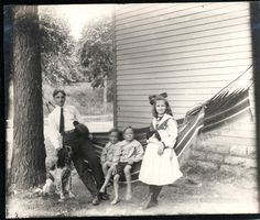 Vintage Photo Family Twin Boys Girl Setter Dog Hammock by House 1904. $5.75, via Etsy.