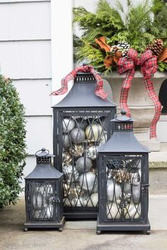 Love the idea of filing lanterns with ornaments to decorate your porch for Christmas! #lanterns #christmas #decorating #porch