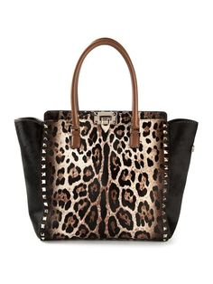 Shop Valentino Garavani 'Rockstud' trapeze tote in August Pfueller from the world's best independent boutiques at farfetch.com. Over 1000 designers from 60 boutiques in one website.