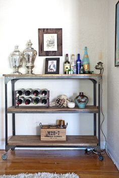 Bar Hutch inspiration Sarah's Warm Bohemian Home House Tour.if you entertain & don't have an actual bar, grab yourself a bar cart! Awesome, fun to stock, pull it out when in use, if not you can tuck it away. Modern Shelving, Industrial Shelves, Industrial Style, Metal Shelving, Warm Industrial, Modular Shelving, Industrial Interiors, Etagere Design, Bar Cart Decor