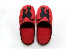 and, I clearly need these slippers for moments when I am enjoying the comforts of my Hazlit Red Cat Wine......  along with my most favorite pj's - which I am wearing right now (huge liteweight cotton green, pink & red plaid bottoms with an old faded american eagle tank).  My life is nice sometimes.  :)  the slippers will have to keep bc the pj's and wine are well underway.