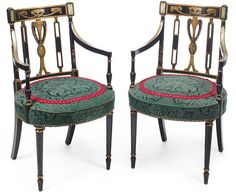 A pair of Regency style parcel gilt ebonized armchairs late 19th century