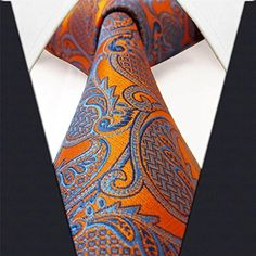 http://www.yourneckties.com/shlax-wing-necktie-men-tie-100-silk-paisley-orange-blue-classic/