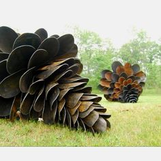 Old shovels arranged into conifer cone by artist Patrick Plourde #repurpose