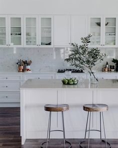 Beautiful NSW family farmhouse dating back to the : Tractor stools from Freedom sit under the island bench, which features a Talostone Carrara Gioia benchtop. Kitchen cabinetry is by Stuart Peart of Castlereagh Cabinets*Photography: Abbie Melle* Farmhouse Style Kitchen, Rustic Kitchen, New Kitchen, Kitchen Ideas, Modern Farmhouse, Awesome Kitchen, Modern Kitchen Decor, White Farmhouse Kitchens, Farmhouse Cabinets