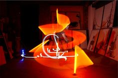 Julien Breton, photographer, calligrapher and light painter releases series of light calligraphy as an identity for the dance and music...this image is the property of Julien Breton