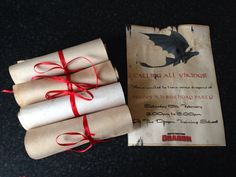 How to Train Your Dragon party invitation. Tea and coffee stained card, ironed, printed on, rolled into scrolls and tied with ribbon.